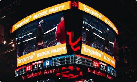 Arena Scoreboard displaying Tangerine Block Party