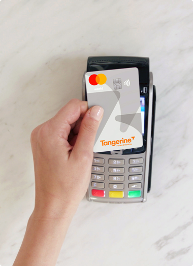A Tangerine Client making a purchase with the World Mastercard